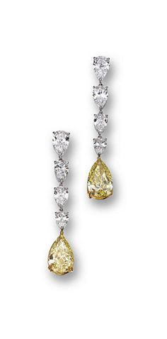 PAIR OF FANCY YELLOW DIAMOND AND DIAMOND PENDANT-EARRINGS.    Designed as fringes of 8 pear-shaped diamonds weighing approximately 6.50 carats, anchored by 2 pear-shaped diamonds of fancy yellow color weighing 5.16 and 5.91 carats, mounted in platinum and 18 karat gold.