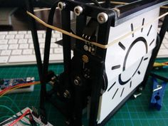 """Internet controlled weather clock that shows the current weather with a split flap display. The weather is retrieved from an API that i build on the <a href=""""http://openweathermap.org"""" target=""""_blank"""">openweathermap.org</a> API. It uses an Arduino Nano with an ethernetshield, infra red sensor for correct positioning the display cards and a 28BYJ-48 stepper motor"""