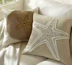 """Jeweled Applique Pillow Covers Starfish: 18"""" square Sand dollar: 20"""" square Pure cotton weave, hidden button closure, reverses to solid ivory. $49.50"""