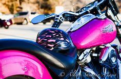Sparkly pink motorcycle with pink flame helmet