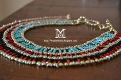 How to make an egyptian inspired necklace using just a beaded chain, colored beads and metallic wire.