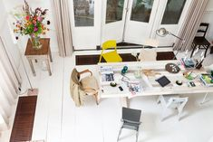 Taan says: This home used to be a kindergarten, but look at it now! Super space, love this white floor, those flowers, big table and yellow chair