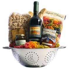 Tuscan Trattoria Italian Wine Gift Basket from Tuscany, Italy - Nestled in a colander are ingredients for savory Italian pasta dinners. Rigantoni pasta, marinara sauce, and prosciutto are paired with Banfi Col di Sasso, a Tu. Themed Gift Baskets, Wine Gift Baskets, Raffle Baskets, Fundraiser Baskets, Get Well Gift Baskets, Food Gift Baskets, Gift Baskets For Men, Wine Gifts, Food Gifts