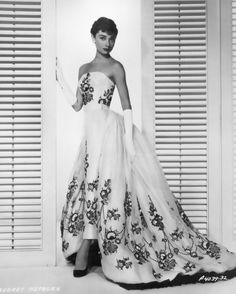 Audrey Hepburn wears Givenchy dress with floral detailing in Sabrina promotional image