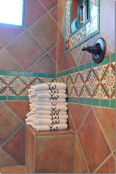 love the branded towels and the Mexican style tile in the shower. [ MexicanConnexionforTile.com ] #design #Talavera #Mexican