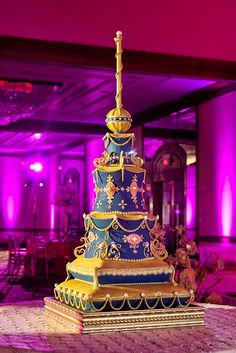 This lavish tiered cake echoes something Jasmine would serve at her wedding. | Photo: @bkcphoto