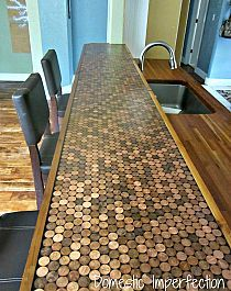 Old laminate counter top covered with pennies and epoxy.