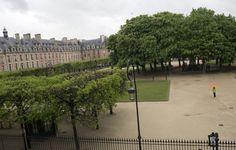 Place de Vosges on a spring rainy day, Paris