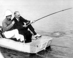 Warren G. Harding, the 29th President of the United States, reeling in a big one in Florida, ca. 1922.