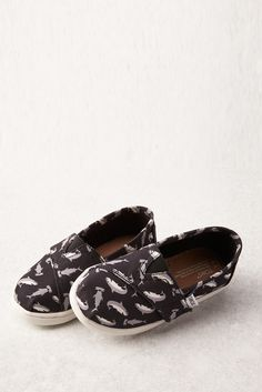 Shark printed tiny TOMS slip-on shoes for your brave little one.