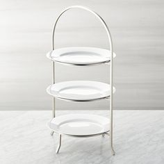 Made of sturdy iron with a nickel-plated finish, this three-tier stand provides a space-saving solution to stacking dinner plates or displaying buffet items. Plates not included.