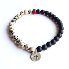 the black white and red seems to be a popular color scheme for men's jewelry