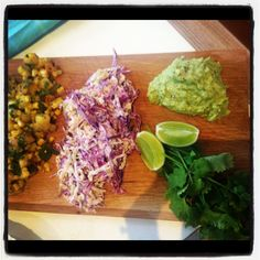 Mexican condiments: low fat coleslaw, guacamole, grilled pineapple & corn salsa