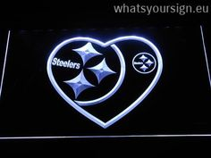 Pittsburgh Steelers Heart - LED neon light sign display made of the premium quality clear acrylic and bright colorful lighting. The neon sign looks exactly the same from all angles thanks to the carving with the latest 3D laser engraving technology. This LED neon sign is a great gift idea! The neon is provided with a metal chain for displaying. Available in 3 sizes in following colours: Green, Purple, Orange, White, Yellow, Red and Blue!
