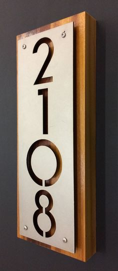 stainless steel, cedar house numbers address plaque by Rancidmetals on Etsy https://www.etsy.com/listing/209854466/stainless-steel-cedar-house-numbers