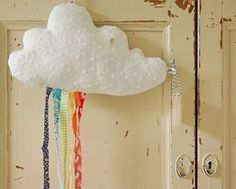 .Puffy cloud with rainbow ribbons