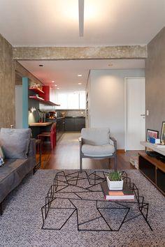 Um lindo apartamento com concreto aparente na decoração
