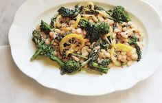Broccoli rabe with white beans.If you like bold, assertive flavors - like broccoli rabe and lemon - this rustic white bean side dish is for you. Try it with roast chicken or pork tenderloin. Vegetable Dishes, Vegetable Recipes, Vegetarian Recipes, Healthy Recipes, Veggie Meals, Lemon Recipes, Side Recipes, Dinner Recipes, Dinner Ideas