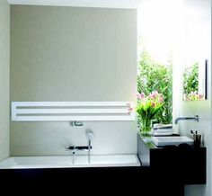 Slim rectangular, minimal radiator from Zehnder.  Product image for Zehnder Metropolitan Horizontal Radiator 595mm