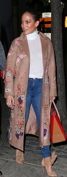 Jennifer Lopez in Coat – Valentino  Shoes and purse – Christian Louboutin