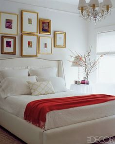 Gold frames in a neutral bedroom.  Love this calming room with the warm red throw.