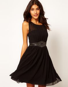 """Classy Black dress for Bridesmaids.   The MOB, (that's me) thinks this style would be so classy, it definitely has a modern """"Audrey Hepburn"""" feel. You can never go wrong with Audrey!!! Also, I recently read that this style dress looks good on EVERY body type. Now that should be the friend of every Bridesmaid! But I'm not voting, just opining."""