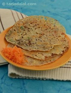 A soft, pancake like dish made with rice flour and grated carrots, the Carrot Dosa is ideal for breakfast or as a snack any time you feel hungry as it can be prepared within minutes without much to do. The addition of grated coconut provides an energy boost and also lends softness to these pancakes. Have these pancakes fresh off the tava, and you will love the crisp yet soft feel of every bite.