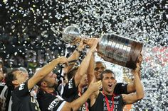 Players of Atletico-MG celebrate the Copa Libertadores title.  http://www.demotix.com/news/2288040/players-atletico-mg-celebrate-copa-libertadores-title#media-2288033