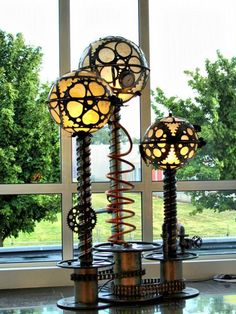 Steampunk Art made from metal scrap and taxidermy into steampunk design lamp, clock and other imaginative objects. All unique steampunk style decoration art pieces.