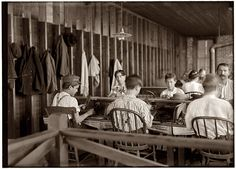 Tampa, Florida. Cigarmakers in the factory of Filogamo & Alvarez, January 1909. Photograph by Lewis Wickes Hine. This part of Tampa is the now fashionably upscale Ybor City district, where many of the old cigar factories have been repurposed as apartments, condos and gallery spaces. Starbucks, anyone?