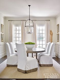 white parsons chairs in a simple but pretty dining room