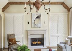 ABOVE Twin chevron-front, built-in cabinets, flank the limestone. Mercury Glass Lamp, Hickory Chair, Country Interior, Tudor House, Built In Cabinets, Cabinet Styles, Shaker Style, Classic House, House In The Woods