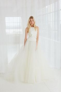 Silk faille high neck bodice ball gown with bow detail at waist and tulle skirt | Miller by Amsale