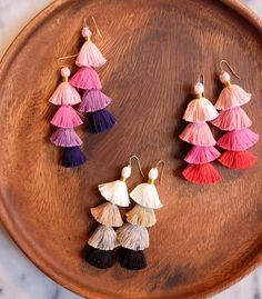 These diy tassel earrings are so fun + easy to make... and they make such a statement! Play around with the different colors...