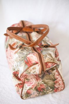 floral duffle luggage bag with leather straps