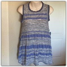 """♣️ Simply Vera Wang bohemian flare tank top This is a very cute flare tank from simply Vera wang. It is a sleeveless top with longer sides and a sheer fabric detail on the neck and arms. Blue and grey striped. Size medium. Made of cotton and polyester. Bust 40""""  All items are from a clean, smoke free home  We ❤️ offers but will only be considered by using the """"OFFER"""" option  Trades  Modeling Simply Vera Vera Wang Tops Tank Tops"""