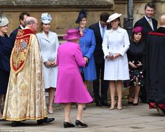 The Queen greets the younger royals, including Peter Phillips and his wife Autumn (fourth from left), as she makes her way into the Easter Mattins church service this morning