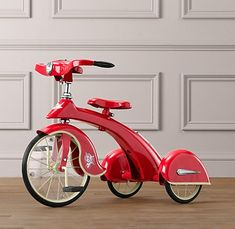 """Sky King Junior Tricycle - red $199  """"Our model is an exact replica of the famous Sky King tricycle from 1936.  Working headlamp, rubber handlebars and solid rubber wheels. Steel with chrome accents. For ages 3–5 years  ....so cute.  i love vintage/retro inspired kids toys....the design just look so much more stylish...."""