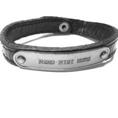 "Marc Jacobs Leather Love Bracelet ""Nemo Nisi Mors"" This is a Marc Jacobs Leather love bracelet. It has the quote ""Nemo Nisi Mors"" on the front silver plate. The meaning behind this phrase is that nothing but death will part us. Cute love bracelet. Very rugged looking. Has a snap button closure. Marc Jacobs Jewelry Bracelets"