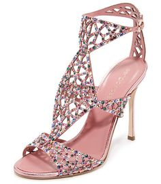 Tresor sandals by Sergio Rossi. Glamorous Sergio Rossi sandals with glittering crystals along delicate, geometric cutouts. Slim buckle at ankle strap...