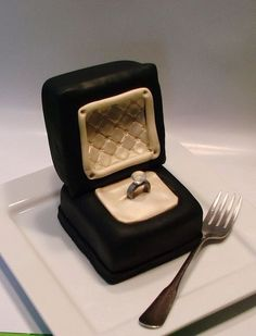 wedding ring box cupcake w/real ring. love this! would only change the colors - chocolate frosting w/yellow cake or butter creme frosting w/red velvet cake...