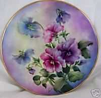 Artist:  D. Maria/Limoge.                                                             Porcelain painting was one of my mum's favorite activities, before arthritis ruined her hands. She would often paint something similar to these pansies. And she was good at it.
