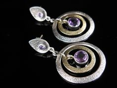 Made with genuine amethyst gemstones and sterling silver findings and post earring backs.