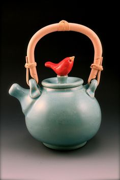 so much to love here. i love pottery birds, because stones that fly? just so archetypally satisfying. that is a brilliant way to manage a handle. also i really like the spout size, shape and position.