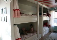A set of quad bunks built into a children's room. Curtains provide each child with their own private space