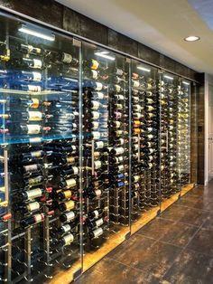 Dennis and Ann Ross decided on a 700-bottle capacity wine wall to suit the contemporary aesthetic of their home. [ Added Oct 3rd