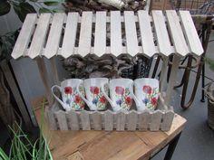 Mugs with flowers by Janneke Brinkman. Licensed by Orange Licensing.