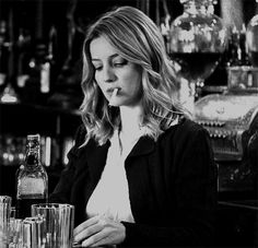 Grace Burgess (played by Annabelle Wallis) that's funny I don't remember her every having a cigarette during the show...?