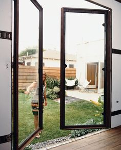 Method Lab - Photo 3 of 14 - The first phase of rehabbing the backyard trailer was fabricating custom steel-and-glass doors. Spanish Bungalow, Zen Garden Design, Prefab Homes, Midcentury Modern, House Tours, Architecture Design, New Homes, Glass Doors, Backyard