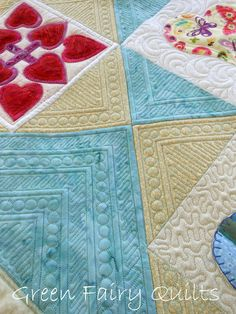 7 | gfquilts | Flickr. I love the way the simple stitches placed together create the effect of a frame around each block.